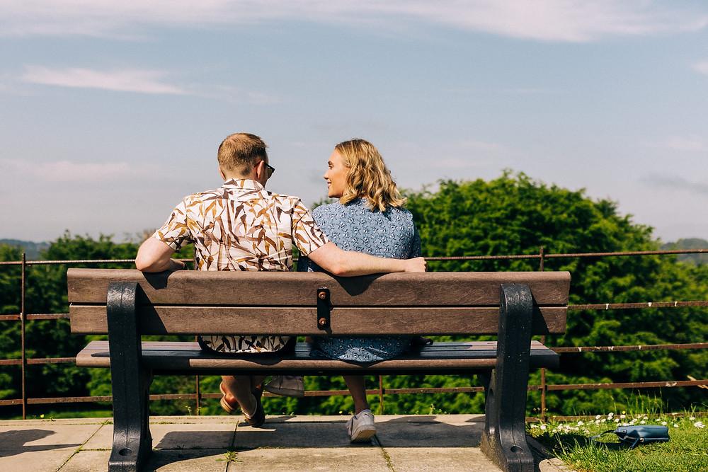 Couple on hill in Durham University engagement shoot romantic