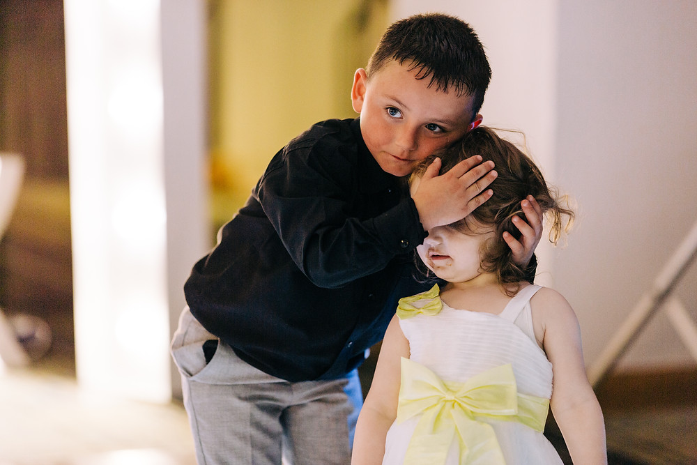 Colourful alternative wedding photography showing kids during reception Holiday Inn Newcastle Jesmond