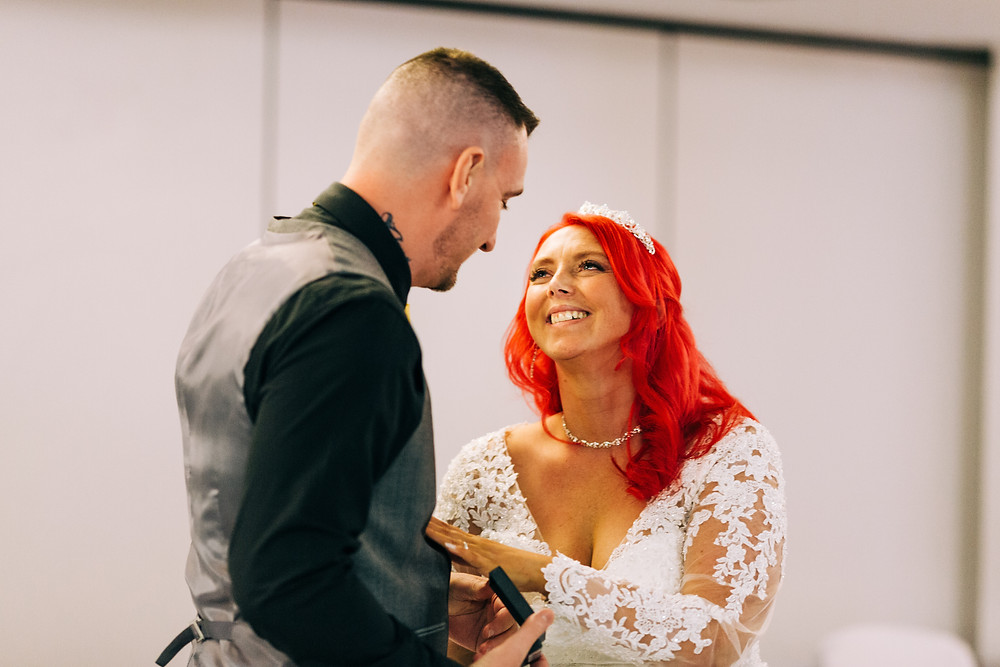 Colourful alternative wedding photography showing bride and groom during special emotional dedication at Holiday Inn Newcastle Jesmond