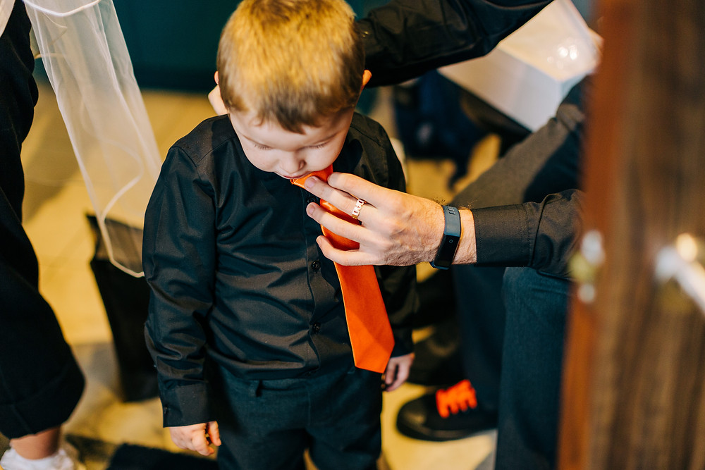Documentary style photography of family getting ready at Holiday Inn Newcastle