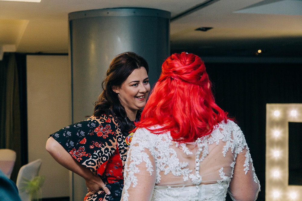 Colourful alternative wedding photography showing bride and guests after ceremony at Holiday Inn Newcastle Jesmond