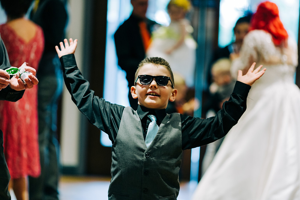 Colourful alternative wedding photography showing kids having fun after ceremony at Holiday Inn Newcastle Jesmond