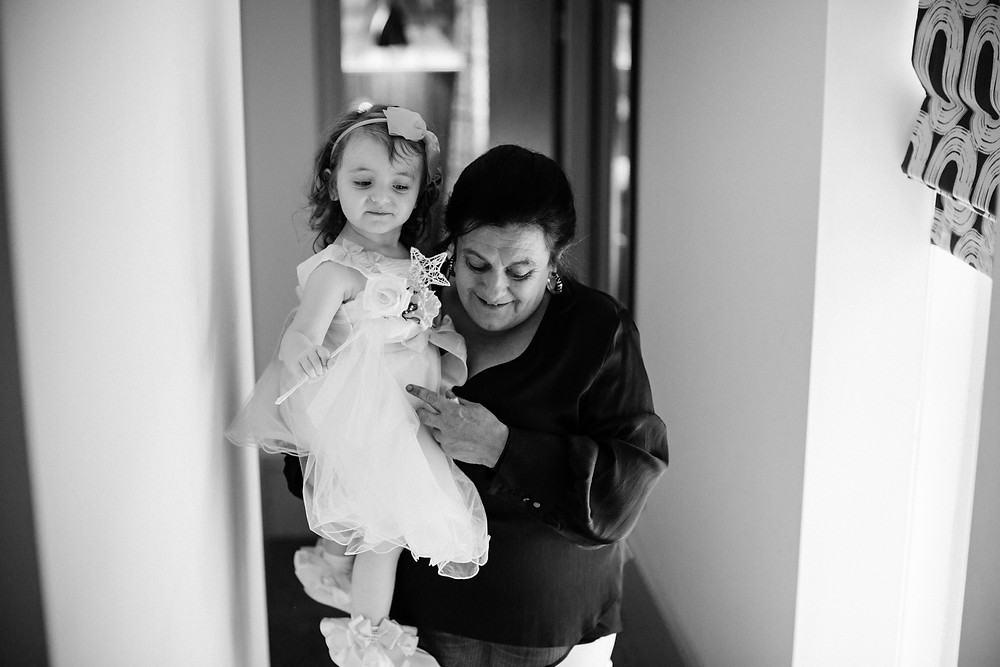Documentary style photo of bride's daughter and mother before ceremony at Holiday Inn Jesmond Newcastle