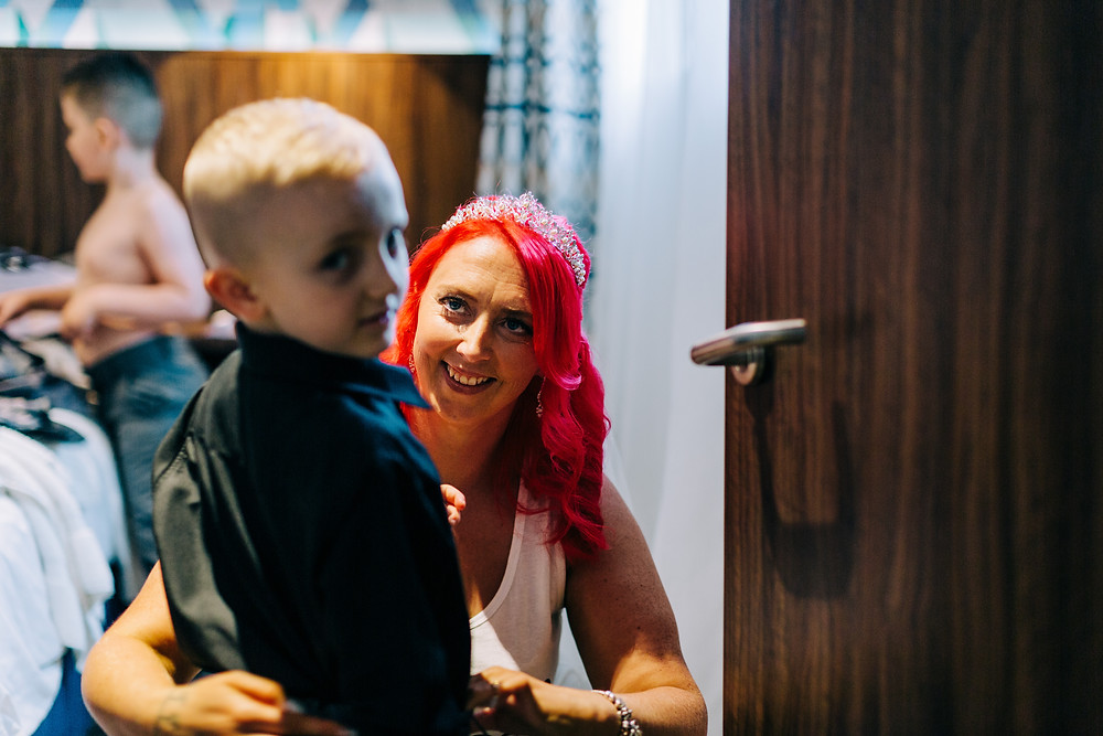 Colourful documentary wedding photography showing bridal and family preparation taken in Jesmond Newcastle Holiday Inn