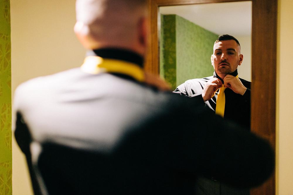 Colourful documentary wedding photography taken at Holiday Inn Jesmond groom prep photos