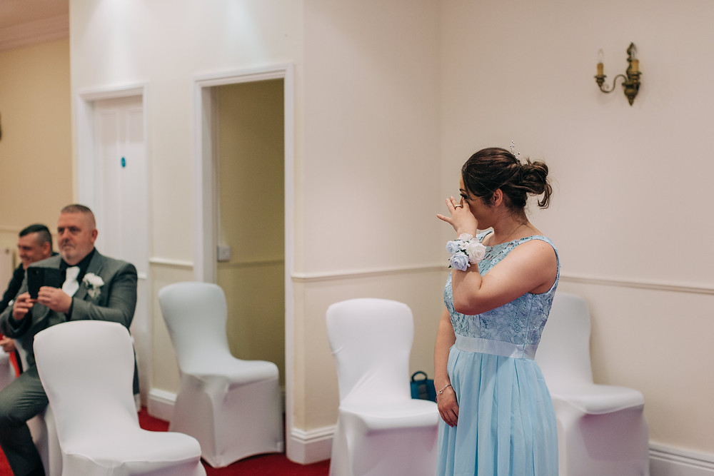 Colourful documentary style wedding photography showing bridesmaid during ceremony Holiday Inn Newcastle Jesmond