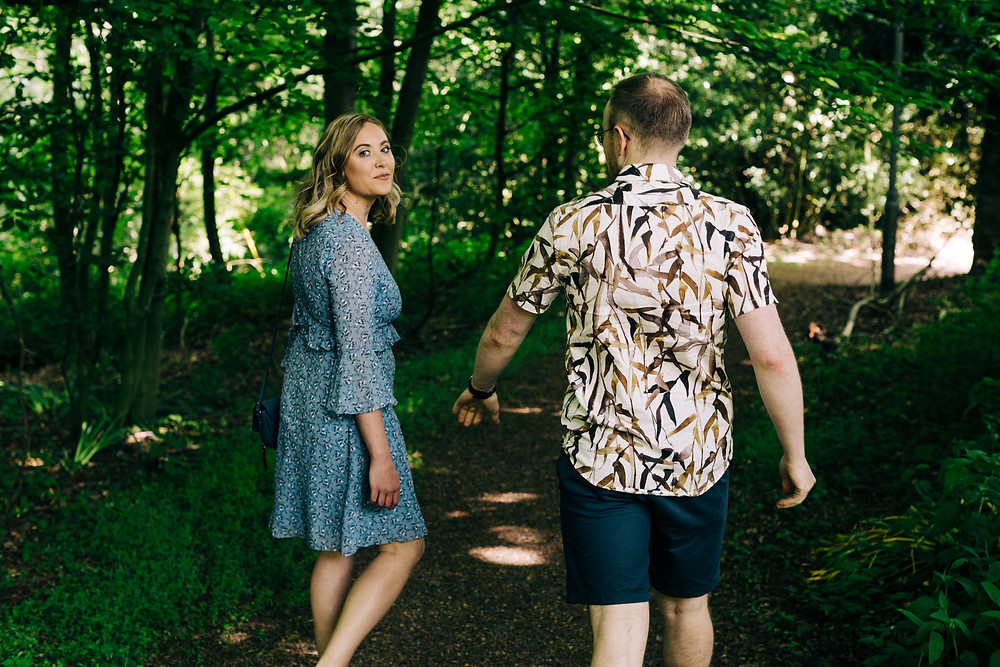 Durham couple walking casual engagement shoot trees