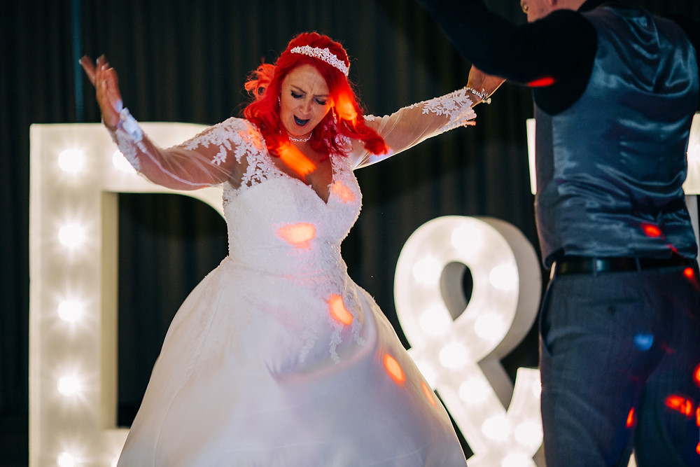 Colourful wedding photography showing first dance at reception Holiday Inn Newcastle