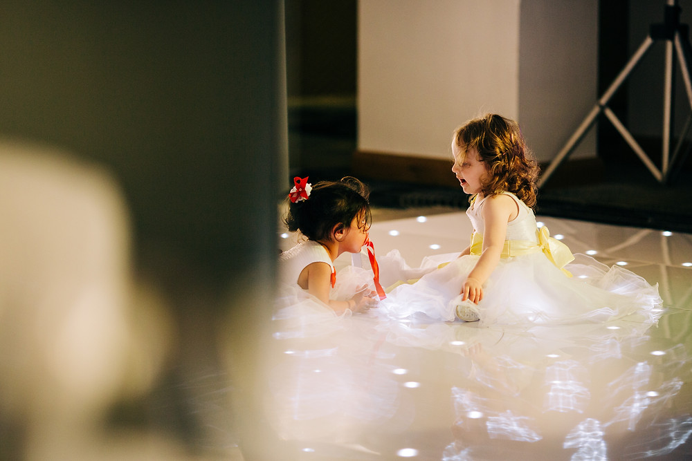 Colourful alternative wedding photography showing kids on dancefloor during reception at Holiday Inn Newcastle Jesmond