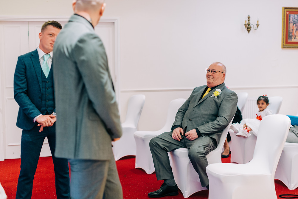 Colourful documentary style wedding photography showing family before ceremony at Holiday Inn Newcastle Jesmond