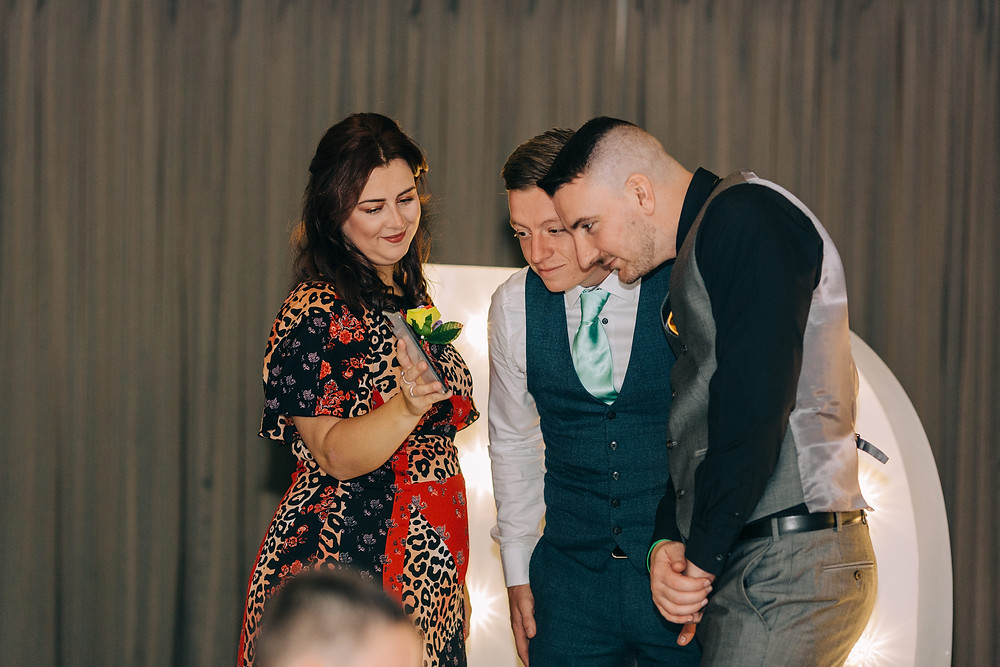 Colourful alternative wedding photography showing groom with friends during reception at Holiday Inn Newcastle Jesmond