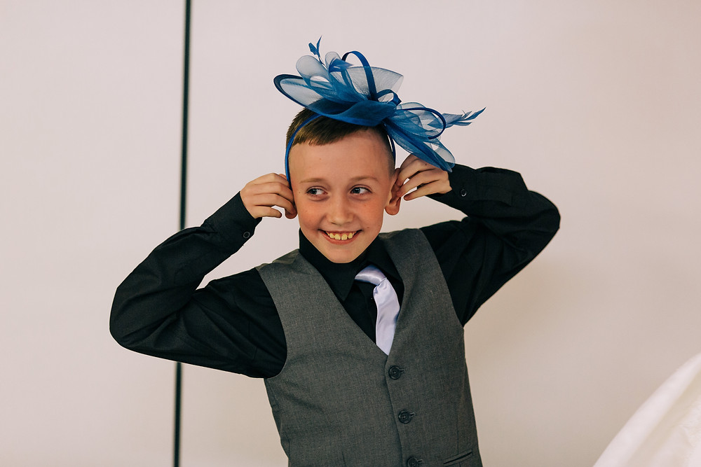 Colourful alternative wedding photography showing bride and groom's son during reception at Holiday Inn Newcastle Jesmond
