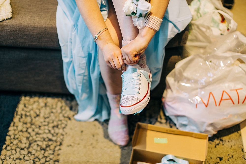 Colourful documentary style wedding photography showing bridesmaid getting ready at Holiday Inn Jesmond Newcastle