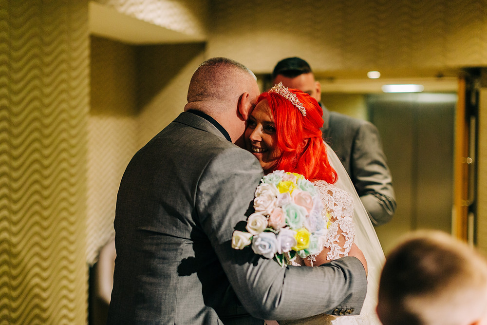 Colourful documentary style wedding photography showing family after ceremony Holiday Inn Newcastle Jesmond