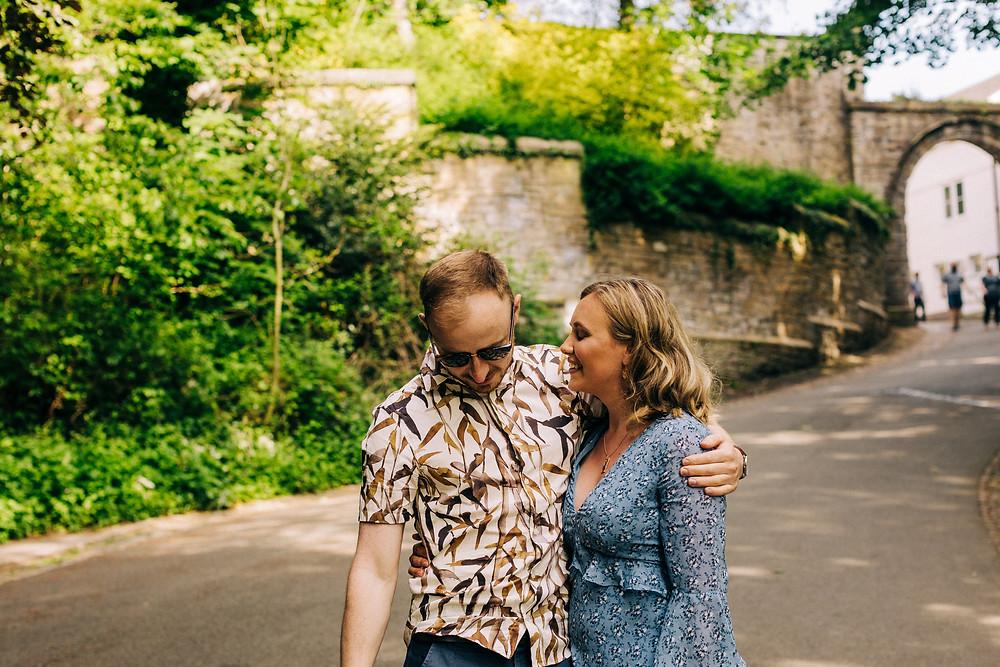 Couple casual romantic hug Durham city prebends bridge engagement shoot