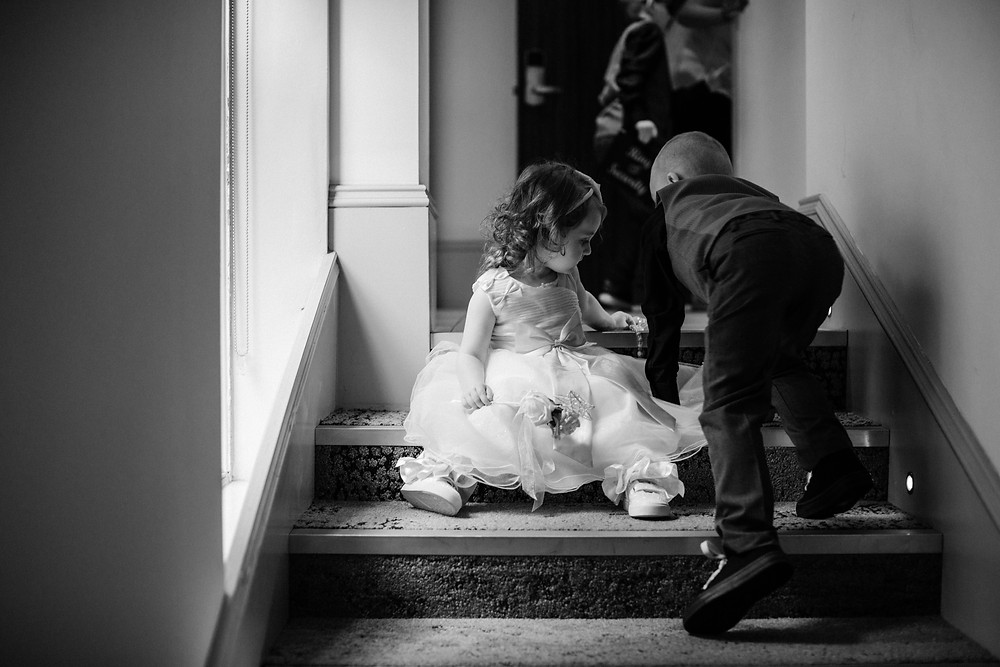Black and white documentary style photo of kids before wedding at Holiday Inn Jesmond Newcastle