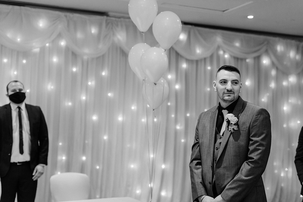 Black and white documentary style wedding photography showing groom before ceremony at Holiday Inn Jesmond Newcastle