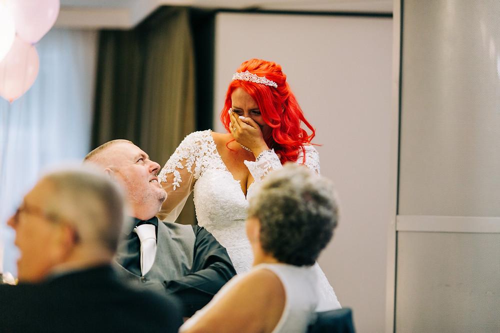 Colourful alternative wedding photography showing bride during emotional dedication at Holiday Inn Newcastle Jesmond