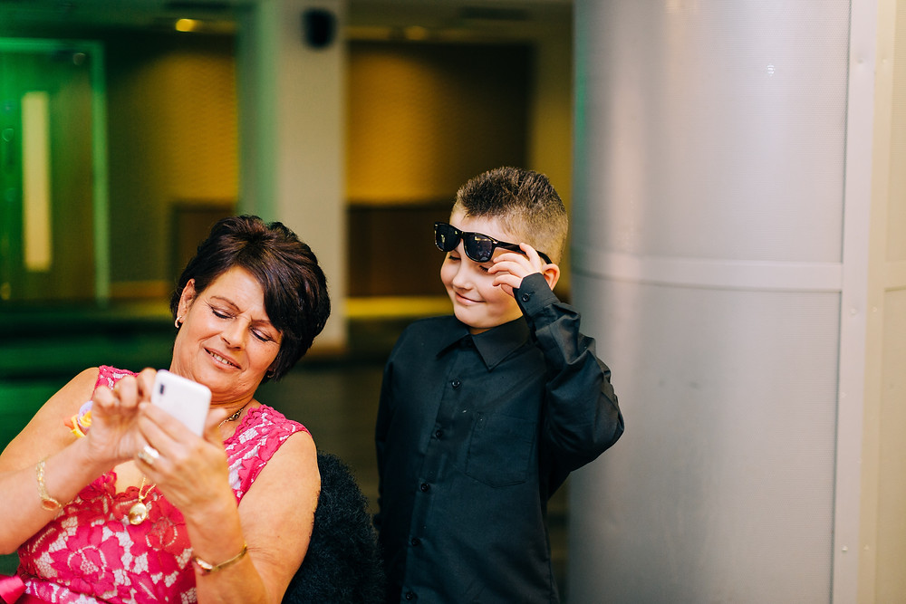 Colourful wedding photography showing family at reception Holiday Inn Newcastle