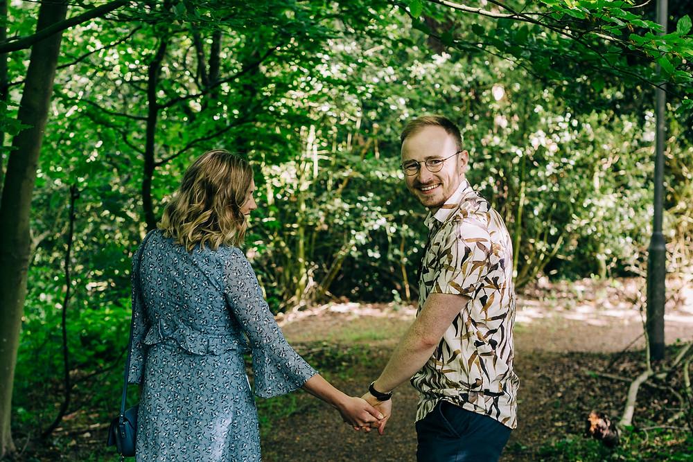 Couple walking engagement shoot Durham university smiling casual
