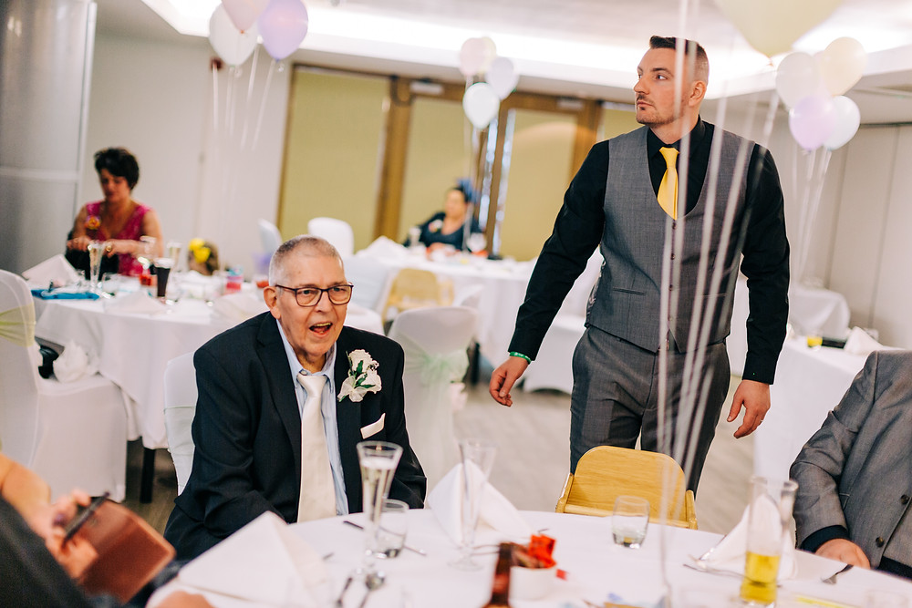 Colourful alternative wedding photography showing family enjoying reception at Holiday Inn Newcastle Jesmond