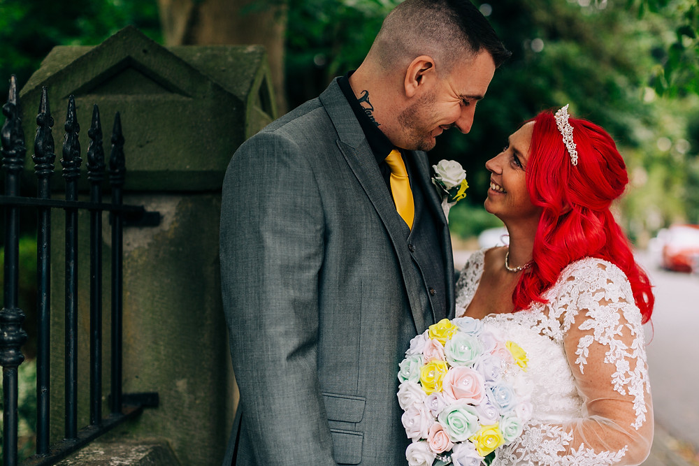 Colourful alternative wedding photography showing bride and groom together in streets during portrait session at Holiday Inn Newcastle Jesmond