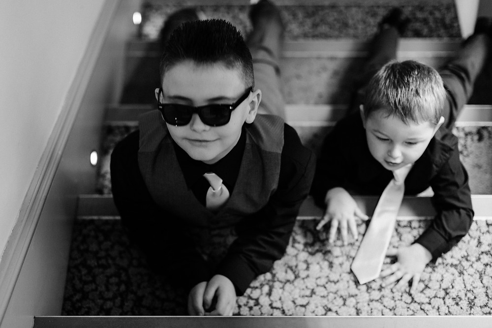 Black and white documentary style wedding photography of kids before ceremony at Holiday Inn Newcastle