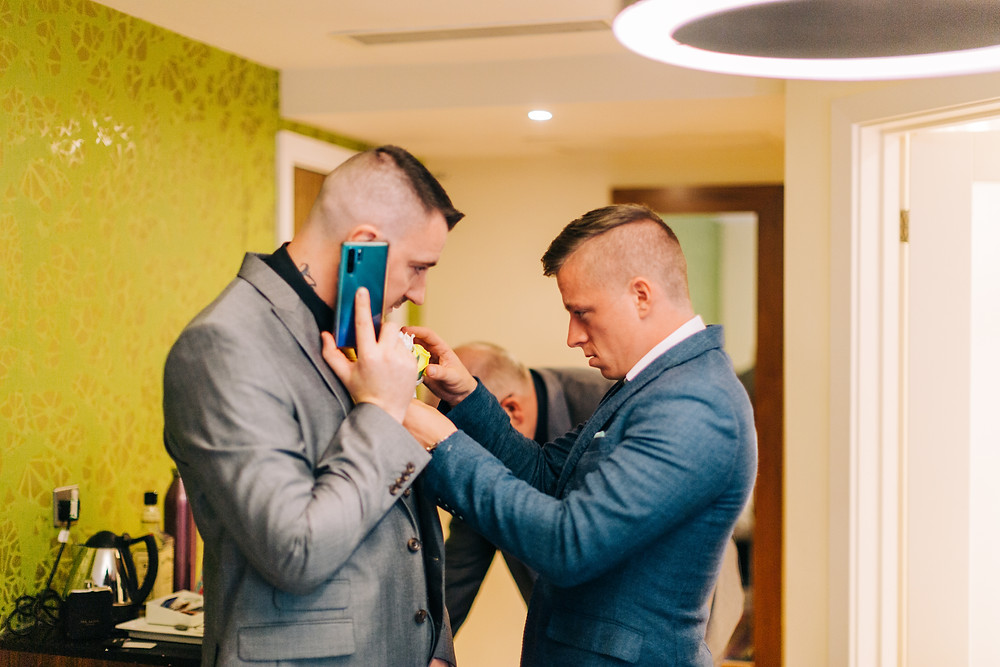 Colourful documentary groom preparation photography taken at Holiday Inn Jesmond Newcastle