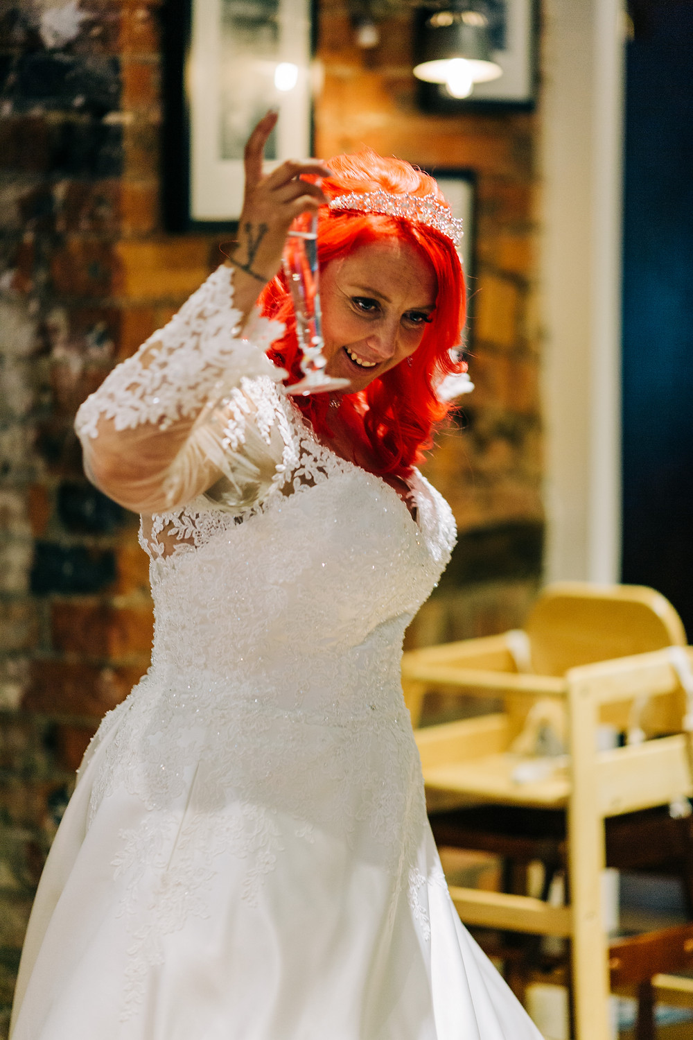 Colourful alternative wedding photography showing bride with drink after ceremony at Holiday Inn Newcastle Jesmond