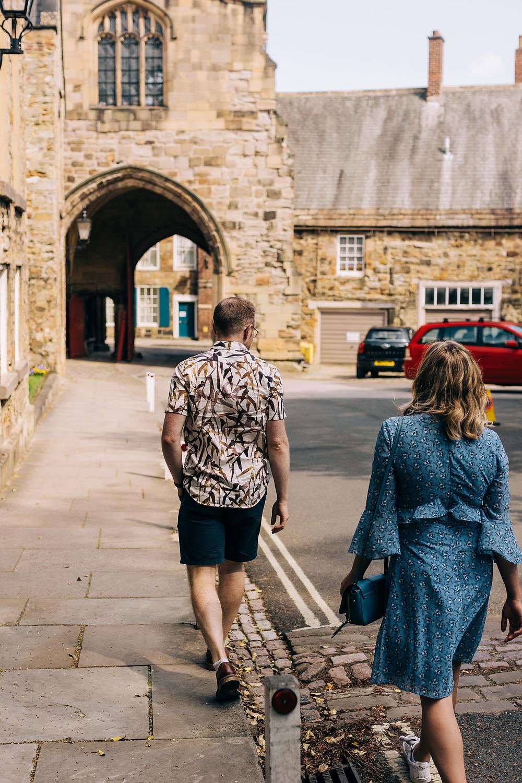 Durham couple walking casual engagement shoot sunny street