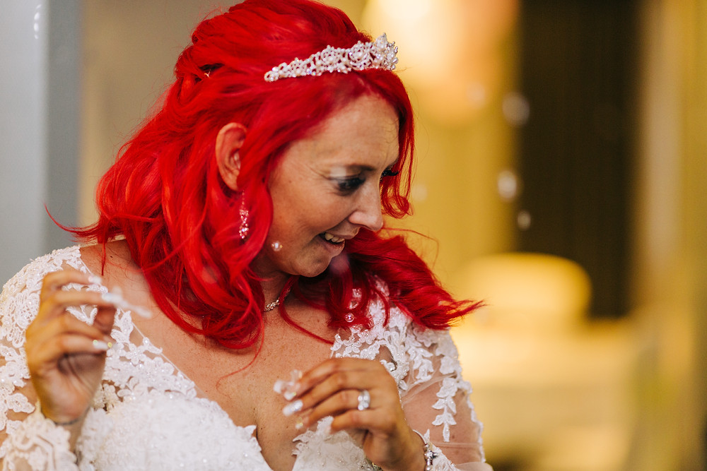 Colourful wedding photography showing bride blowing bubbles at reception Holiday Inn Newcastle