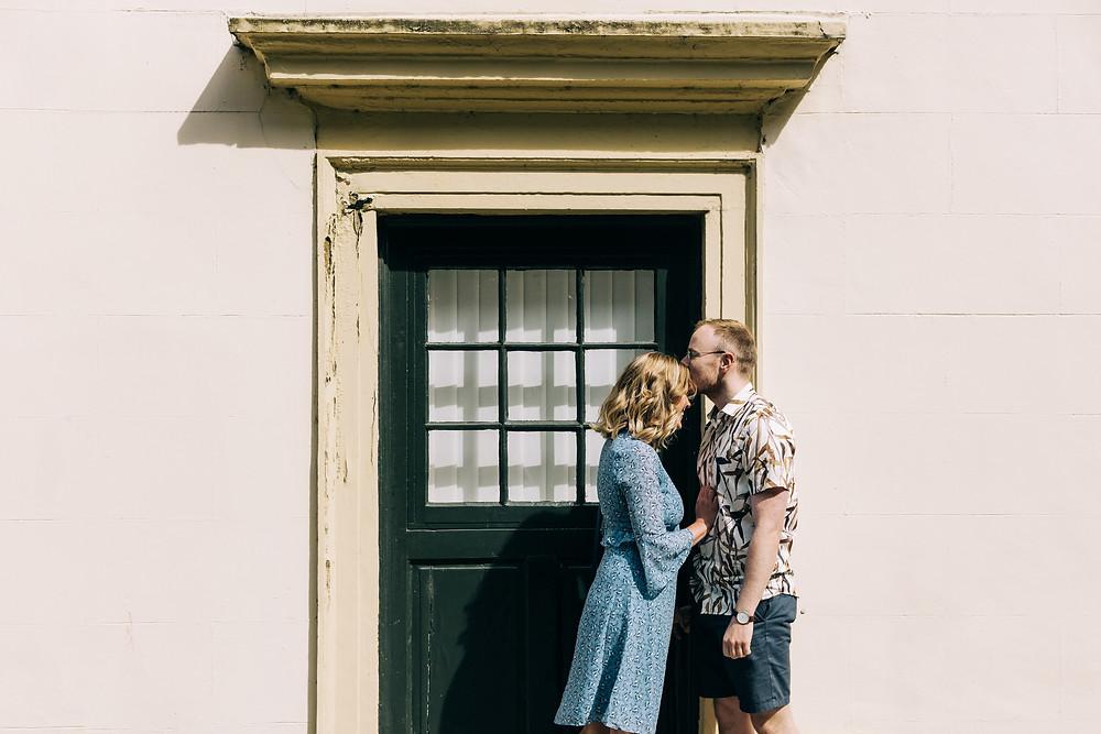 Durham city engagement couples photo shoot romantic kiss doorway