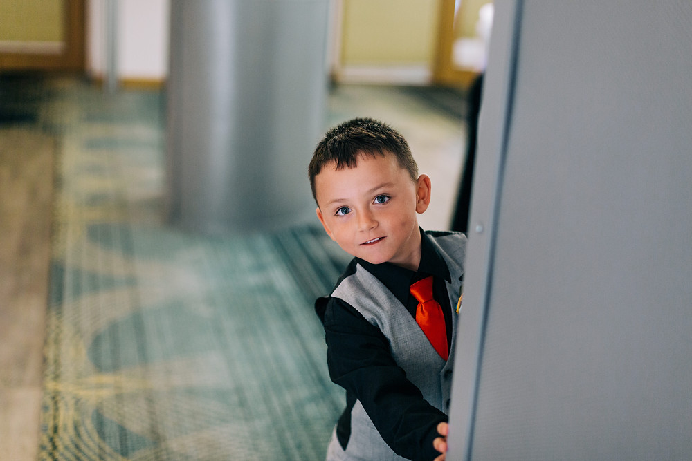 Colourful documentary style wedding photography showing kids after ceremony Holiday Inn Newcastle Jesmond