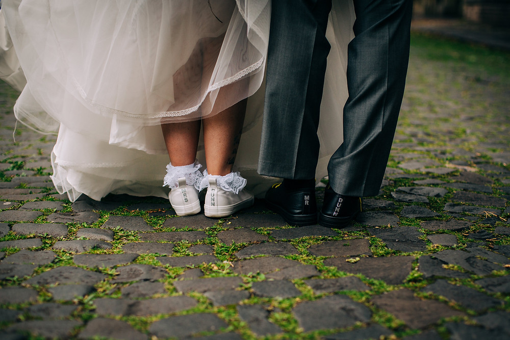 Colourful alternative wedding photography showing details of couple's shoes near Holiday Inn Newcastle Jesmond