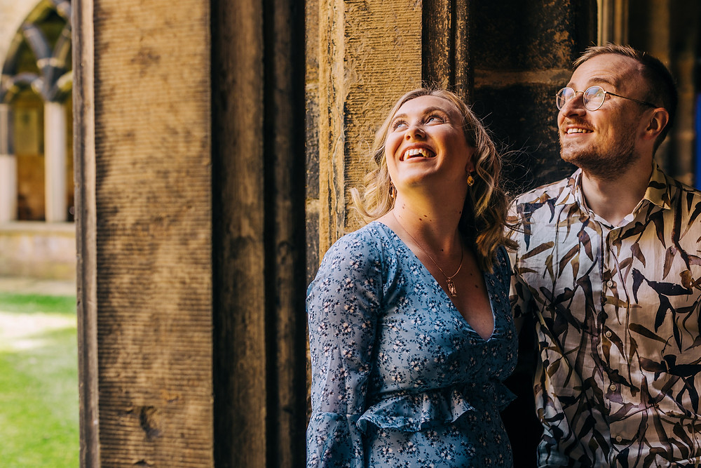 Couples engagement shoot Durham city centre Cathedral university wedding smiling