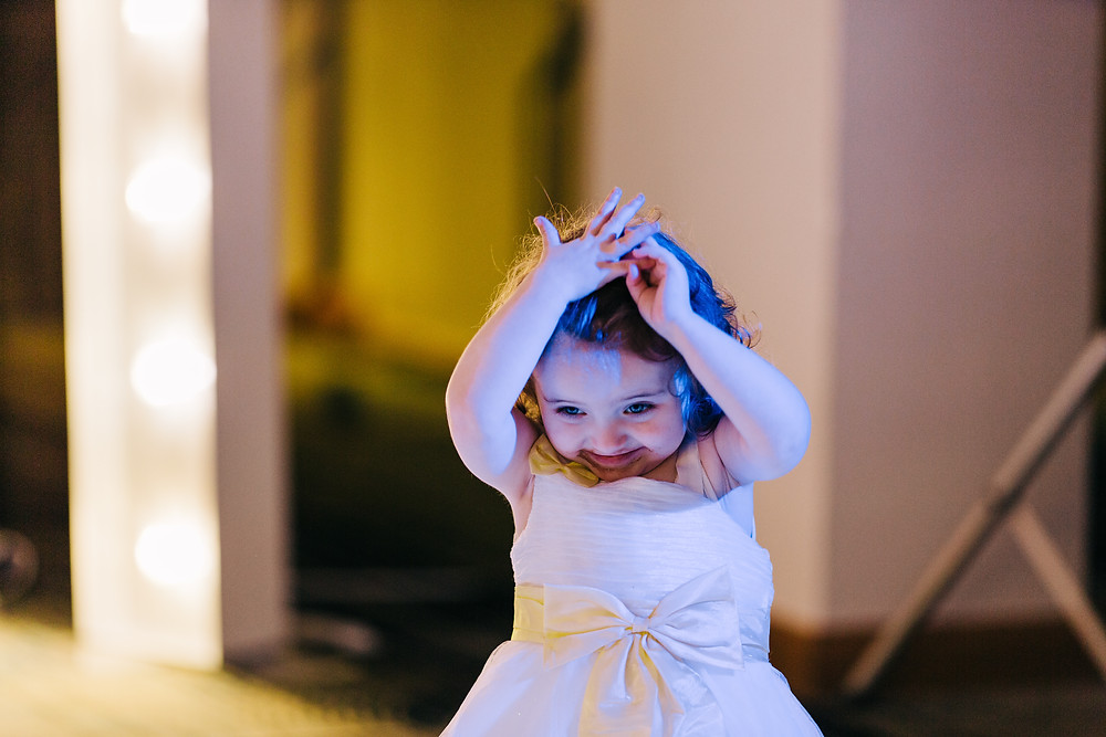Colourful alternative wedding photography showing daughter during reception at Holiday Inn Newcastle Jesmond