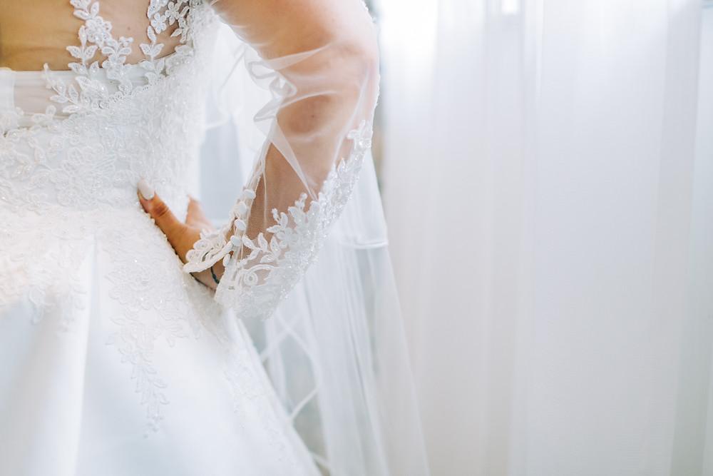 Colourful documentary style wedding photo of bride's dress at Holiday Inn Newcastle Jesmond