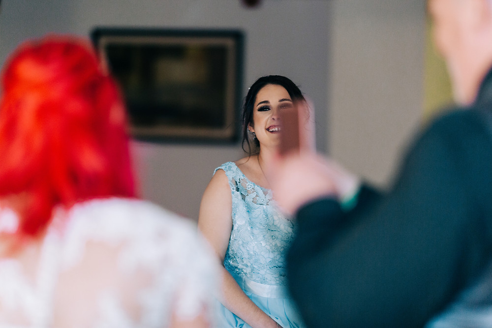 Colourful wedding photography showing happy guests at reception Holiday Inn Newcastle