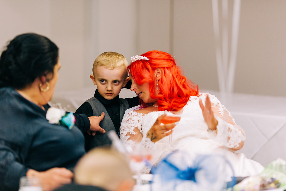 Colourful wedding photography showing bride and family at reception Holiday Inn Newcastle
