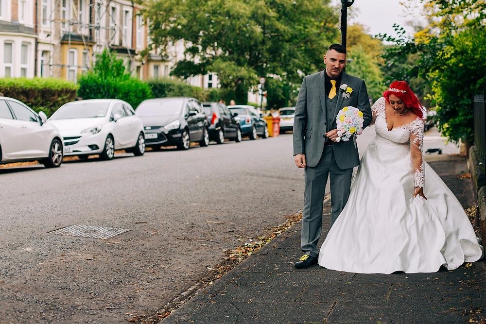 Colourful alternative wedding photography showing bride and groom walking down street near Holiday Inn Newcastle Jesmond