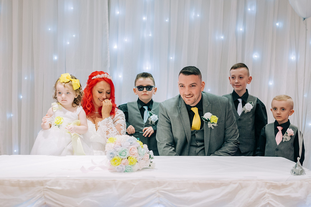 Colourful documentary style wedding photography showing couple and kids during ceremony Holiday Inn Newcastle Jesmond