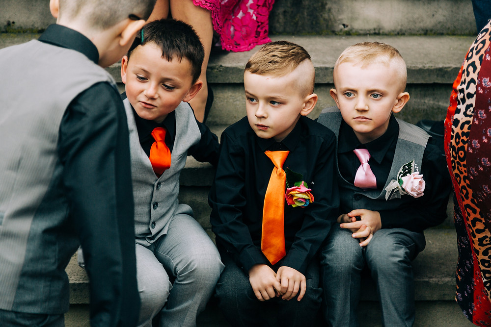 Colourful alternative wedding photography showing kids after ceremony at Holiday Inn Newcastle Jesmond