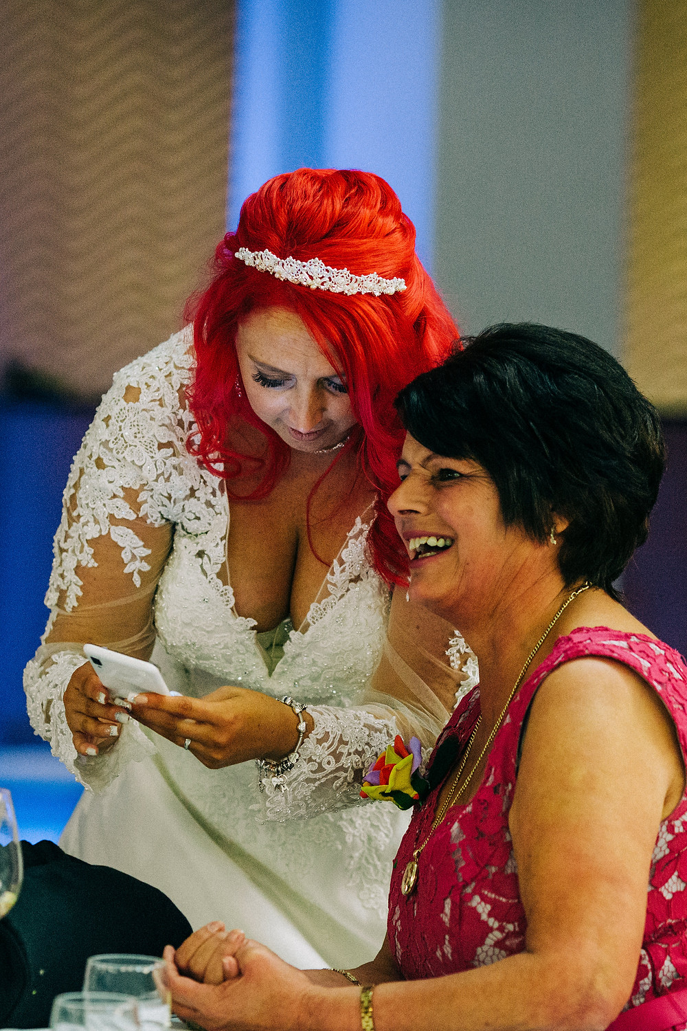 Colourful alternative wedding photography showing bride with family during reception at Holiday Inn Newcastle Jesmond