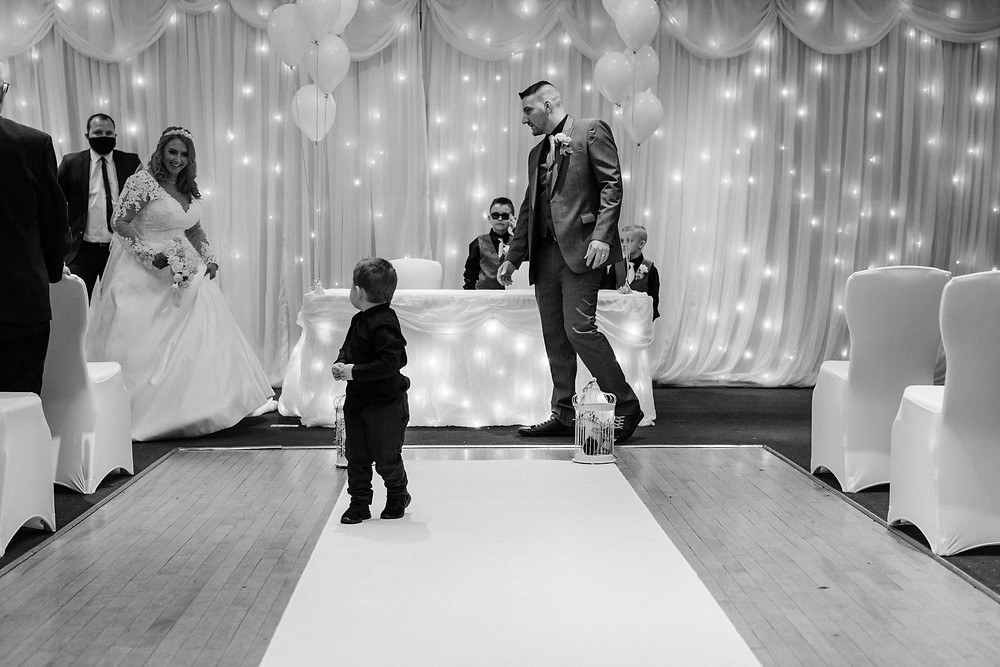Black and white documentary style photos of wedding ceremony at Holiday Inn Newcastle Jesmond