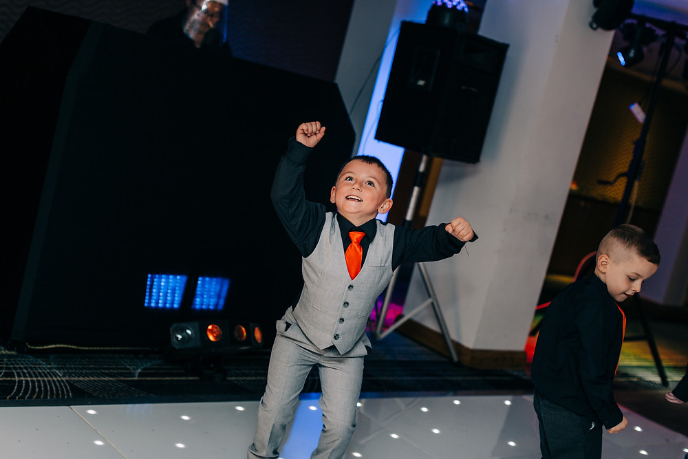 Colourful alternative wedding photography showing kids dancing at reception at Holiday Inn Newcastle Jesmond