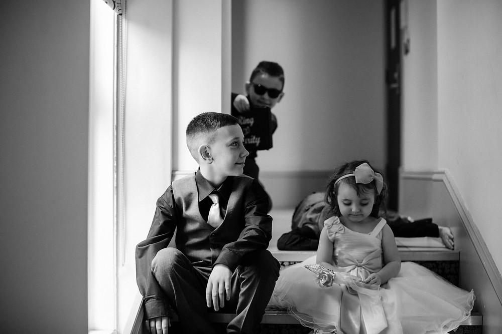 Black and white documentary style wedding photo of kids before wedding at Holiday Inn Jesmond