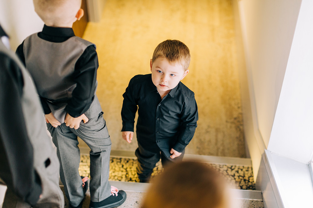 Colourful documentary style funny photo of kids before ceremony at Newcastle Holiday Inn Jesmond