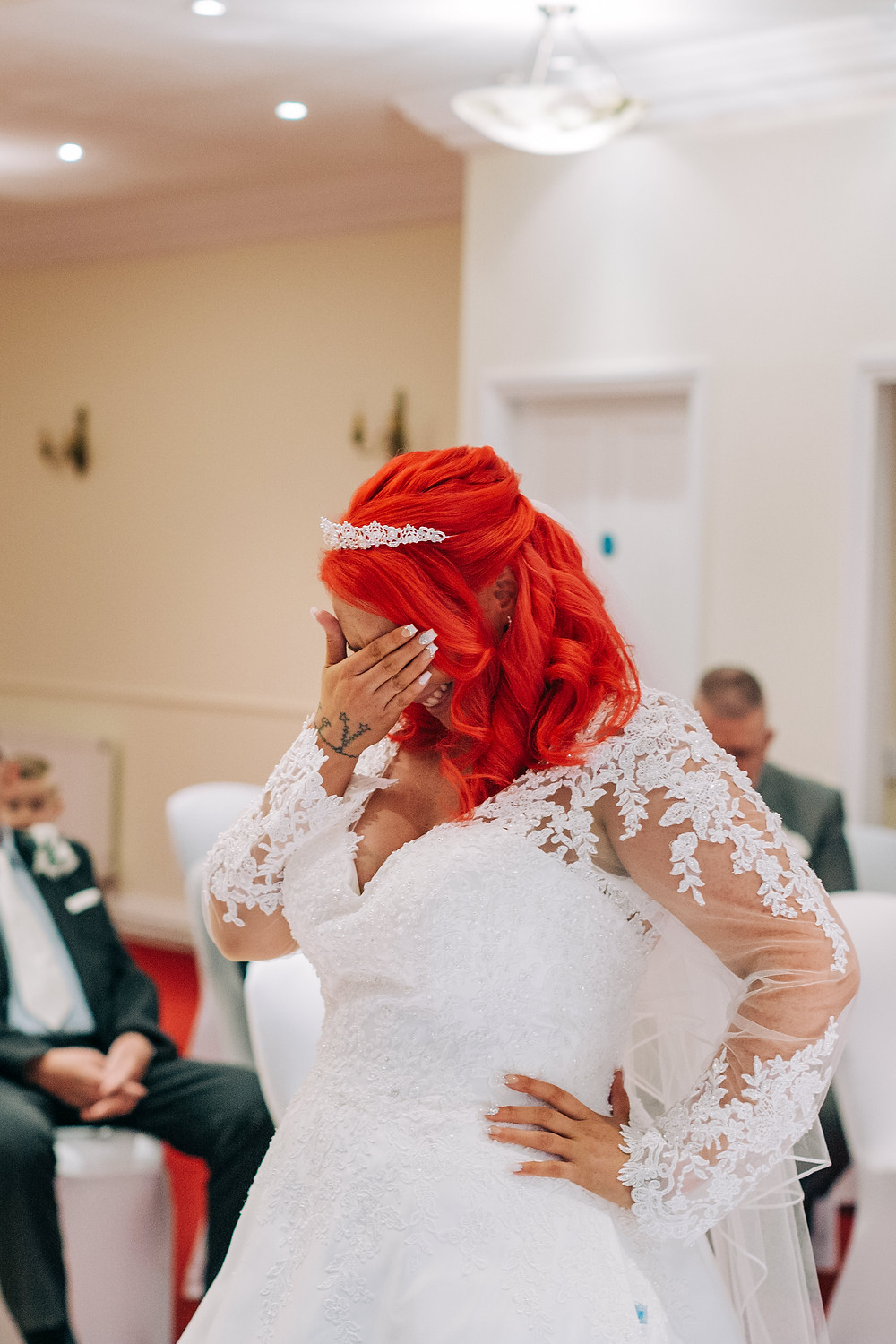 Colourful documentary style wedding photography showing bride during ceremony Holiday Inn Newcastle Jesmond