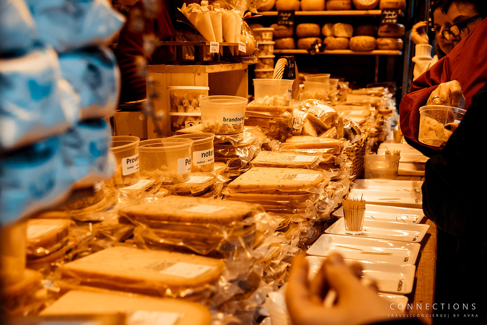 Christmas market chalet selling cheese. Bruges, Belgium