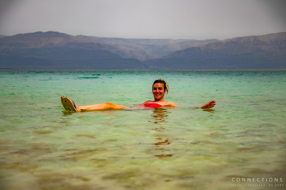 Women floating and relaxing in the mineral rich Dead Sea